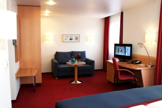 Deluxe Zimmer mit Sitzecke im Garden Hotel Bremen